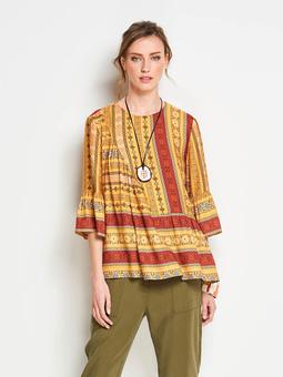Свободная блузка с асимметричными деталями