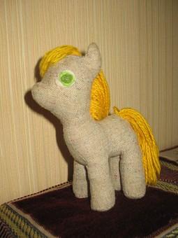Работа с названием Текстильная игрушка лошадка