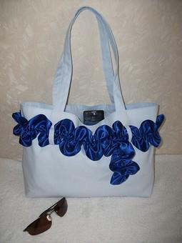 Работа с названием Текстильная пляжная сумка