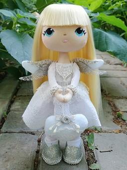 Работа с названием Текстильная кукла-ангел